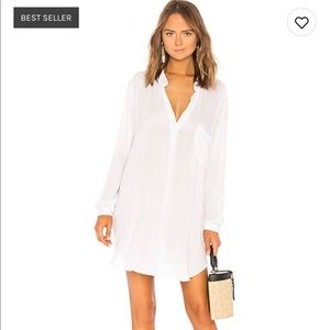 Long white shirt. Blouse.